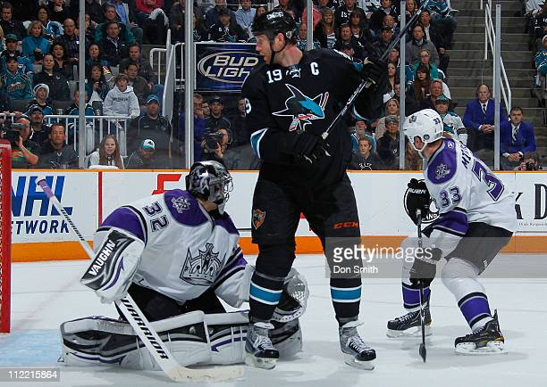 Joe Thornton of the San Jose Sharks looks for the puck against Jonathan Quick and Willie Mitchell of the Los Angeles Kings in Game 1 of the Western...