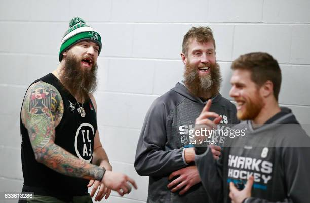 Joe Thornton of the San Jose Sharks looks on as teammate Brent Burns yells at Joe Pavelski during a soccer match before their NHL game against the...