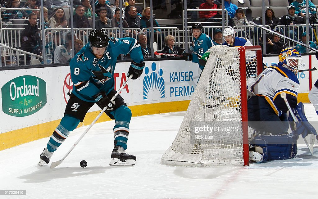 Joe Thornton #8 of the San Jose Sharks looks to make a pass to the front the net against Brian Elliott #1 of the St. Louis Blues during a NHL game at the SAP Center at San Jose on March 22, 2016 in San Jose, California.