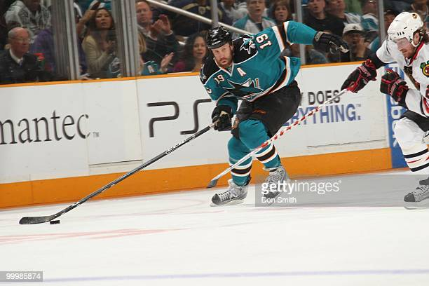 Joe Thornton of the San Jose Sharks moves the puck up ice in Game One of the Western Conference Finals during the 2010 NHL Stanley Cup Playoffs...