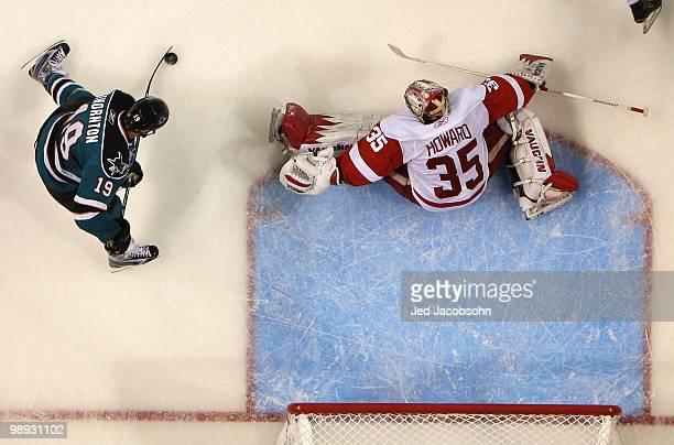 Joe Thornton of the San Jose Sharks scores against Jimmy Howard of the Detroit Red Wings in Game Five of the Western Conference Semifinals during the...