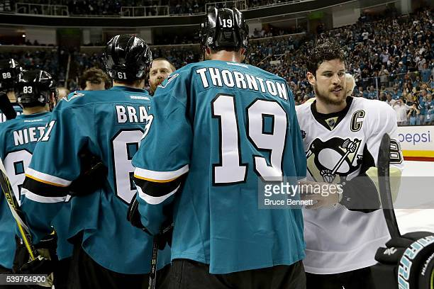 Joe Thornton of the San Jose Sharks shakes hands with Sidney Crosby of the Pittsburgh Penguins after losing Game Six 31 and the 2016 NHL Stanley Cup...