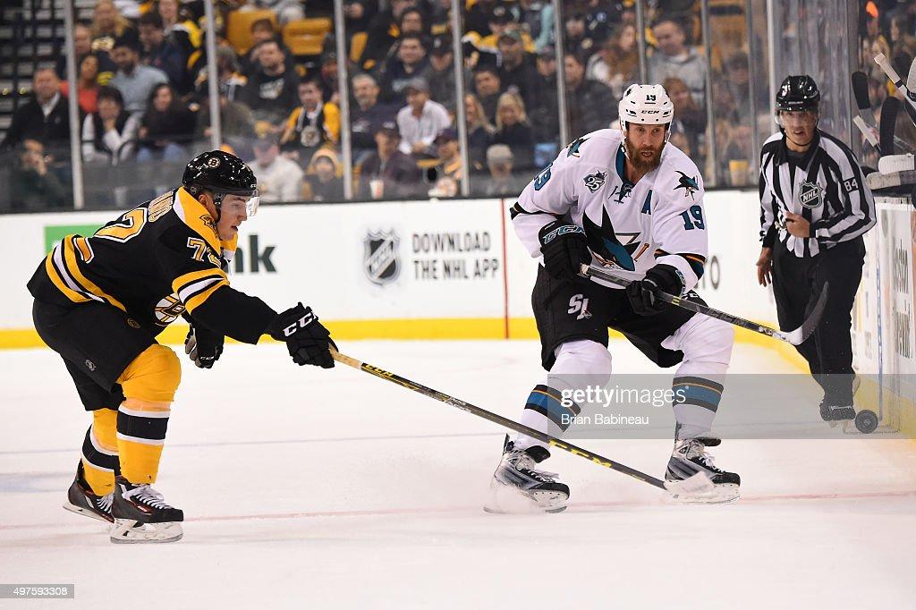 Joe Thornton #19 of the San Jose Sharks skates after the puck against Frank Vatrano #72 of the Boston Bruins at the TD Garden on November 17, 2015 in Boston, Massachusetts.