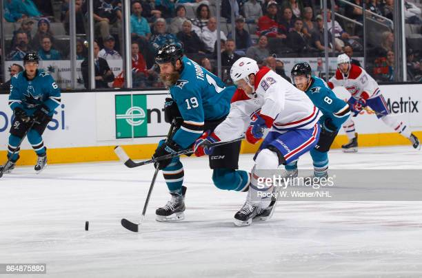 Joe Thornton of the San Jose Sharks skates after the puck against Ales Hemsky of the Montreal Canadiens at SAP Center on October 17 2017 in San Jose...