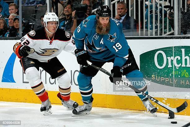 Joe Thornton of the San Jose Sharks skates against Josh Mason of the Anaheim Ducks during a NHL game at SAP Center at San Jose on November 26, 2016...