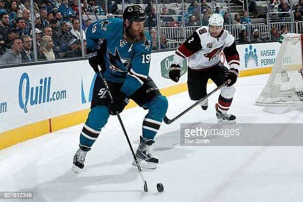 Joe Thornton of the San Jose Sharks skates against Luke Schenn of the Arizona Coyotes during a NHL game at SAP Center at San Jose on November 29,...