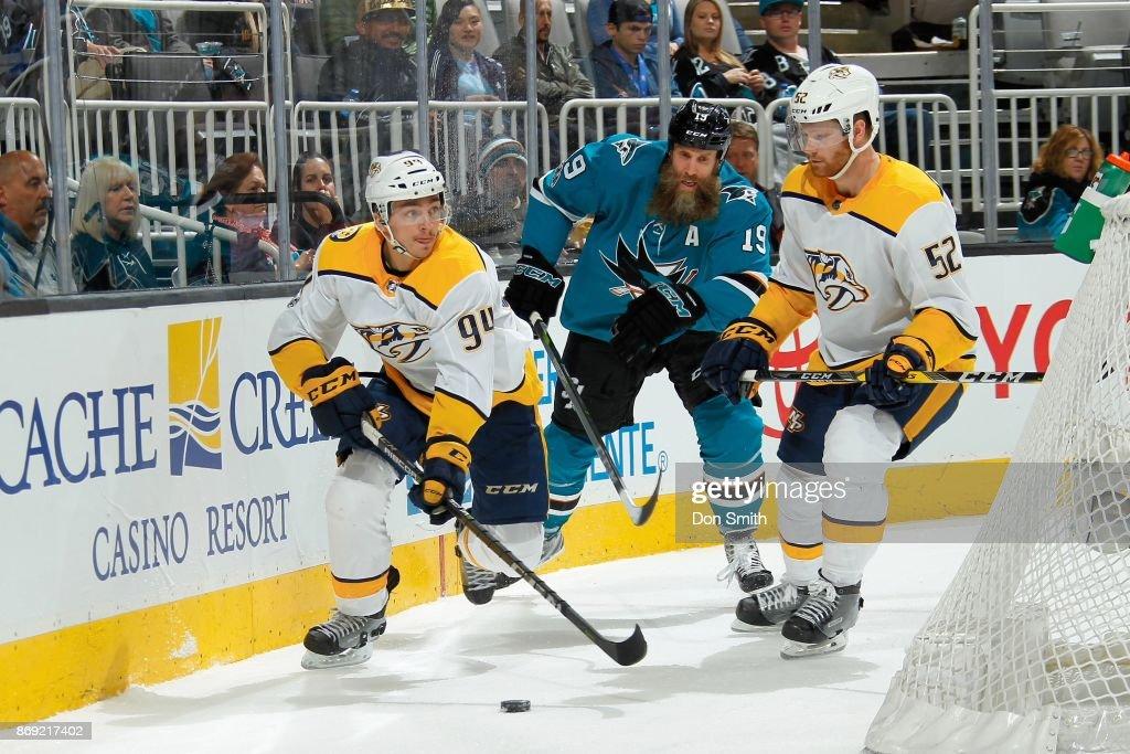 Joe Thornton #19 of the San Jose Sharks skates against Samuel Girard #94 and Matt Irwin #52 of the Nashville Predators at SAP Center on November 1, 2017 in San Jose, California.