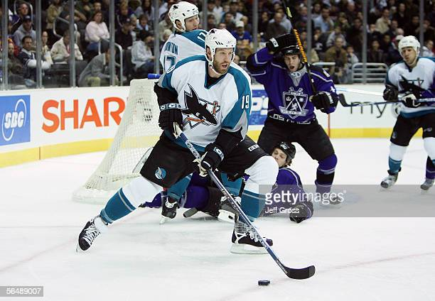 Joe Thornton of the San Jose Sharks skates with the puck during the first period of the game against the Los Angeles Kings at the Staples Center on...