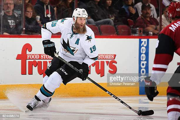 Joe Thornton of the San Jose Sharks skates with the puck during the second period of the NHL game against the Arizona Coyotes at Gila River Arena on...