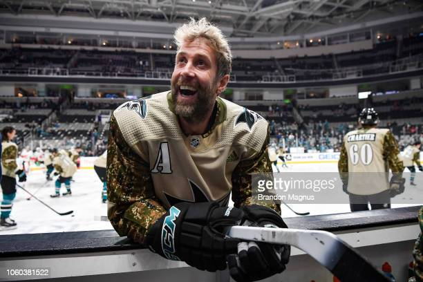 Joe Thornton of the San Jose Sharks smiles to the crowd during warmups before the game against the Calgary Flames at SAP Center on November 11 2018...