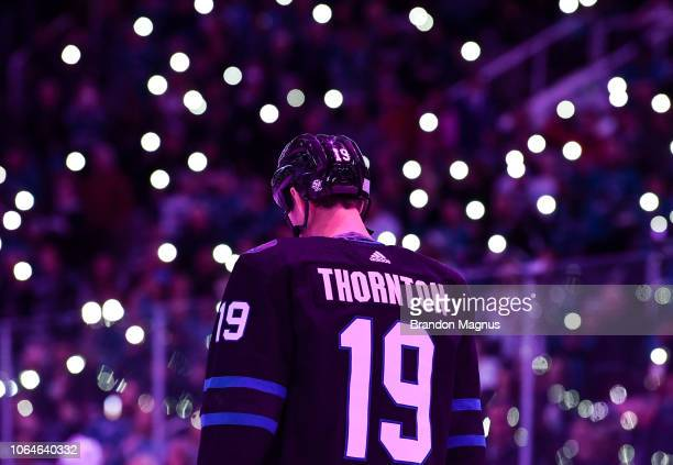 Joe Thornton of the San Jose Sharks stands for a moment of silence before the game against the Vancouver Canucks at SAP Center on November 23, 2018...