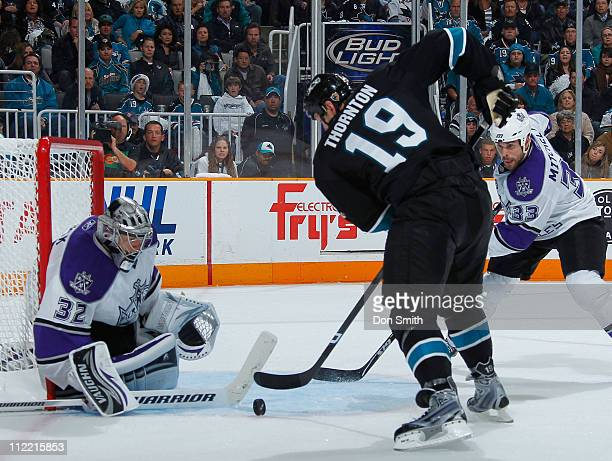 Joe Thornton of the San Jose Sharks tries to score against Jonathan Quick and Willie Mitchell of the Los Angeles Kings in Game 1 of the Western...