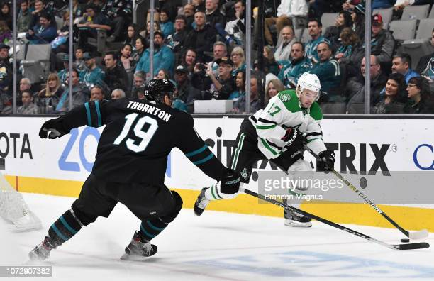 Joe Thornton of the San Jose Sharks tries to steal the puck from Devin Shore of the Dallas Stars at SAP Center on December 13 2018 in San Jose...