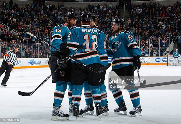 Joe Thornton, Patrick Marleau and Jason Demers of the San Jose Sharks celebrate Marleau's goal against the Toronto Maple Leafs during an NHL game on...