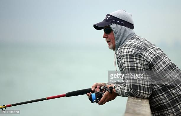 Joe Thuma of Ft Lauderdale waits for a strike at Anglin's Fishing Pier in LauderdalebytheSea Tuesday Jan 7 2013 Fishermen on the pier were bundled up...