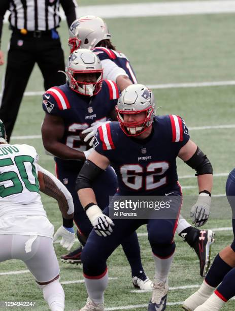 Joe Thuney of the New England Patriots is the lead blocker on a running play against the New York Jets at Gillette Stadium on January 3, 2021 in...
