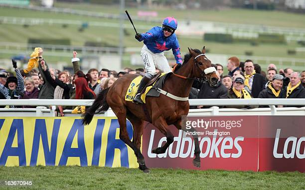 Joe Tizzard celebrates on Cue Card after victory in the Ryanair Chase during the Cheltenham Festival at Cheltenham Racecourse on March 14 2013 in...