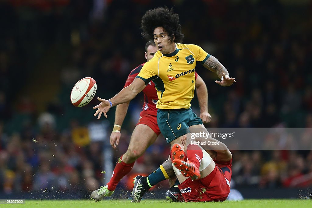 Joe Tomane of Australia offloads as Alun Wyn Jones of Wales holds on in the tackle during the International match between Wales and Australia at the Millennium Stadium on November 8, 2014 in Cardiff, Wales.
