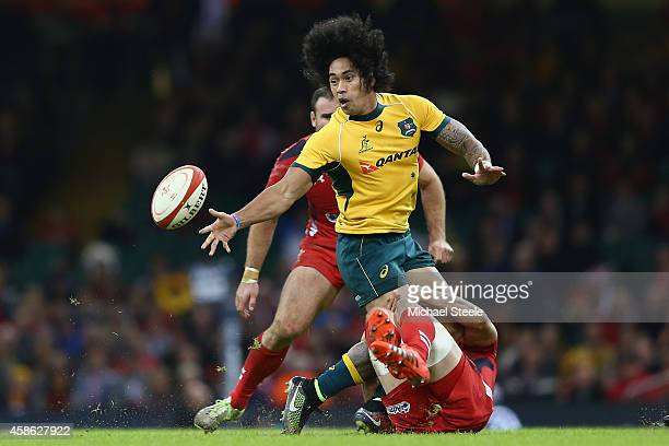 Joe Tomane of Australia offloads as Alun Wyn Jones of Wales holds on in the tackle during the International match between Wales and Australia at the...