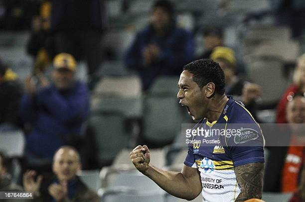 Joe Tomane of the Brumbies celebrates afters scoring a try during the round 11 Super Rugby match between the Brumbies and the Force at Canberra...