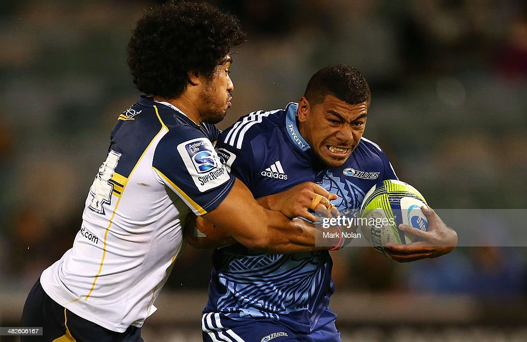 Joe Tomane of the Brumbies tackles Charles Piutau of the Blues during the round eight Super Rugby match between the Brumbies and the Bulls at Canberra Stadium on April 4, 2014 in Canberra, Australia.