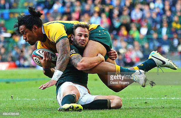 Joe Tomane of the Wallabies is tackled by Francois Hougaard during The Rugby Championship match between the South African Springboks and the...