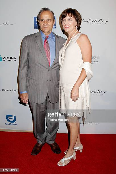 Joe Torre and Alice Wolterman attend the 13th annual Harold Carole pump Foundation Gala at The Beverly Hilton Hotel on August 9 2013 in Beverly Hills...