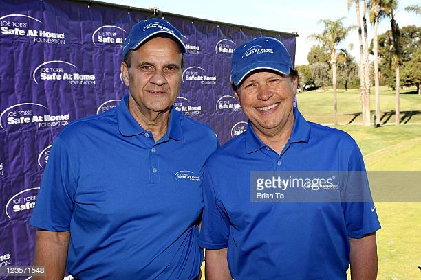 Joe Torre and Billy Crystal pose at Joe Torre Safe at Home foundation 2011 Golf classic at Wilshire Country Club on January 24 2011 in Los Angeles...