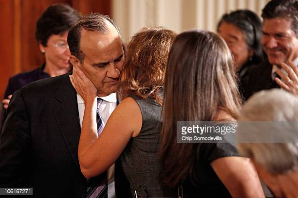 Joe Torre former Major League Baseball player and manager and founder of the Safe at Home Foundation gets a kiss from his wife Alice Wolterman after...