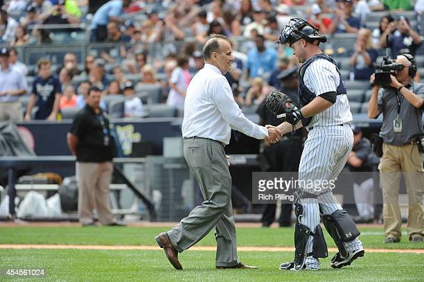 Joe Torre former manager of the New York Yankees is seen with Brian McCann after throwing out the Ceremonial First Pitch during Joe Torre Day prior...