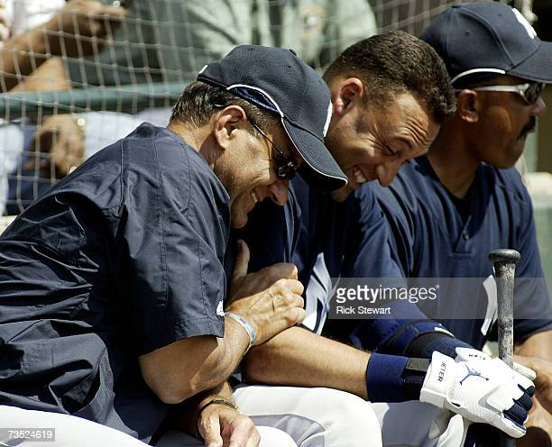 Joe Torre Manager of the New York Yankees laughs with Derek Jeter prior to a Spring Training game against the Atlanta Braves on March 8 2007 at The...