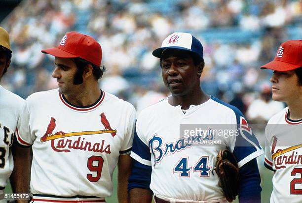 Joe Torre of the St Louis Cardinals stands alongside Hank Aaron of the Atlanta Braves before the MLB All Star Game at FultonCounty Stadium on July 25...