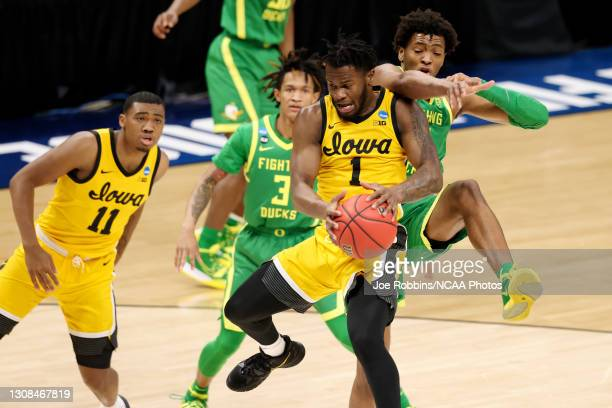 Joe Toussaint of the Iowa Hawkeyes grabs a rebound against the Oregon Ducks in the second round of the 2021 NCAA Division I Men's Basketball...
