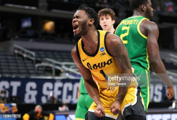Joe Toussaint of the Iowa Hawkeyes reacts to a turnover against the Oregon Ducks in the second round game of the 2021 NCAA Men's Basketball...