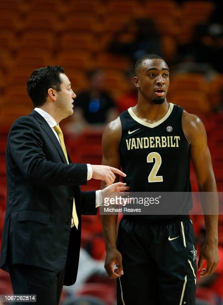 Joe Toye of the Vanderbilt Commodores talks with head coach Bryce Drew against the North Carolina State Wolfpack during the HoopHall Miami...