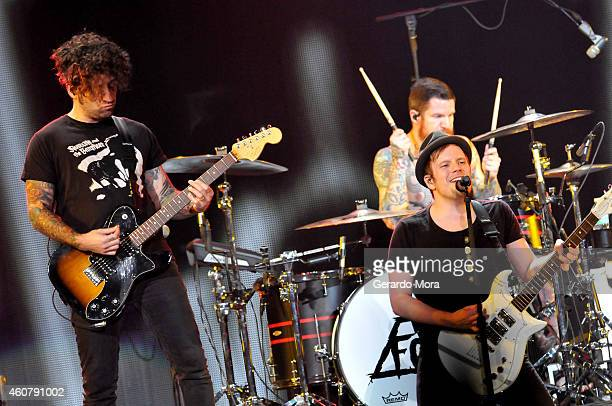 Joe Trohman, Andy Hurley and Patrick Stump of Fall Out Boy performs onstage during 93.3 FLZ's Jingle Ball 2014 at Amalie Arena on December 22, 2014...
