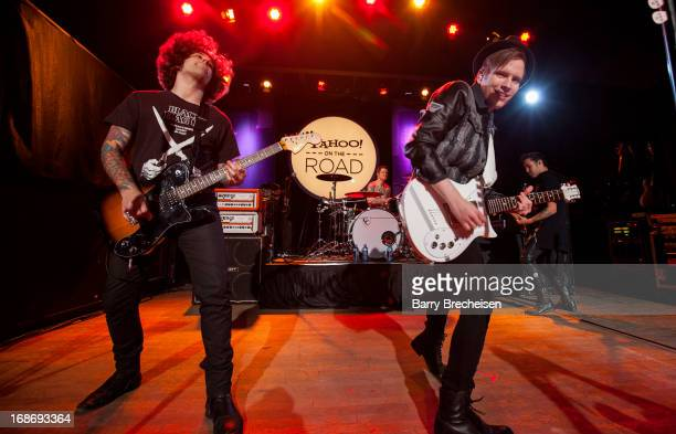 Joe Trohman Andy Hurley Patrick Stump and Pete Wentz of Fall Out Boy perform during Yahoo On The Road at Majestic Theatre on May 13 2013 in Madison...