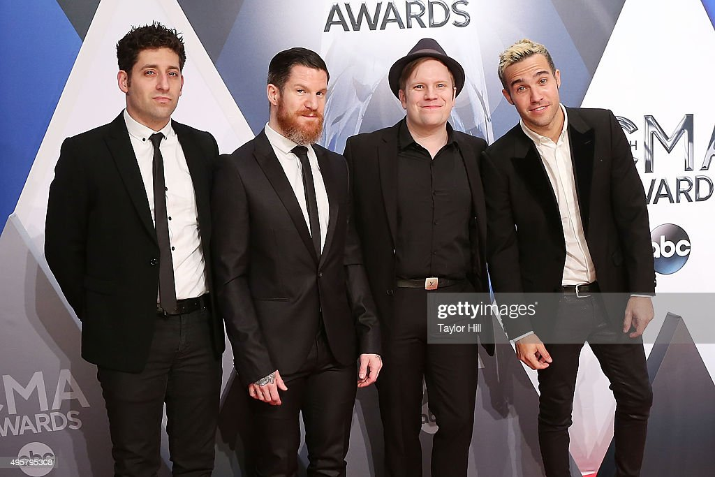 Joe Trohman, Andy Hurley, Patrick Stump, and Pete Wentz of Fall Out Boy attend the 49th annual CMA Awards at the Bridgestone Arena on November 4, 2015 in Nashville, Tennessee.