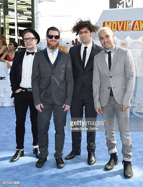 Joe Trohman Andy Hurley Patrick Stump and Pete Wentz of music group Fall Out Boy arrive at the 2015 MTV Movie Awards at Nokia Theatre LA Live on...