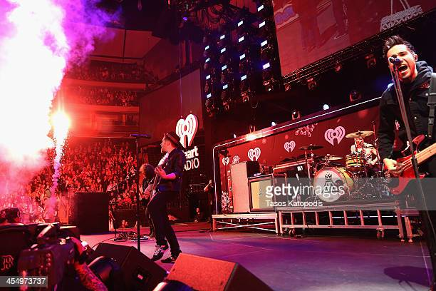Joe Trohman, Patrick Stump, Andy Hurley, and Pete Wentz of Fall Out Boy perform onstage during 101.3 KDWB's Jingle Ball 2013, at Xcel Energy Center...