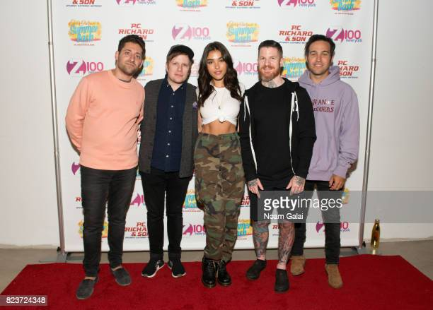 Joe Trohman Patrick Stump Andy Hurley and Pete Wentz of Fall Out Boy pose with Madison Beer at Elvis Duran's 2017 Summer Bash at the Pennsy Plaza on...