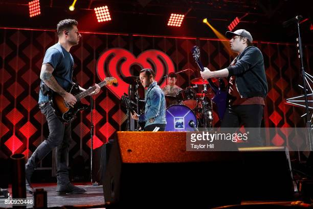 Joe Trohman Pete Wentz Andy Hurley and Patrick Stump of Fall Out Boy perform during the 2017 Z100 Jingle Ball on December 11 2017 in Washington DC