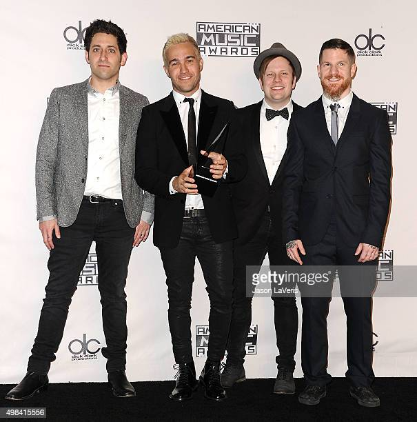 Joe Trohman Pete Wentz Patrick Stump and Andy Hurley of Fall Out Boy pose in the press room at the 2015 American Music Awards at Microsoft Theater on...