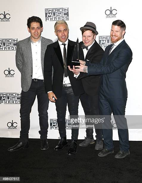 Joe Trohman Pete Wentz Patrick Stump and Andy Hurley of Fall Out Boy pose in the press room at Microsoft Theater on November 22 2015 in Los Angeles...