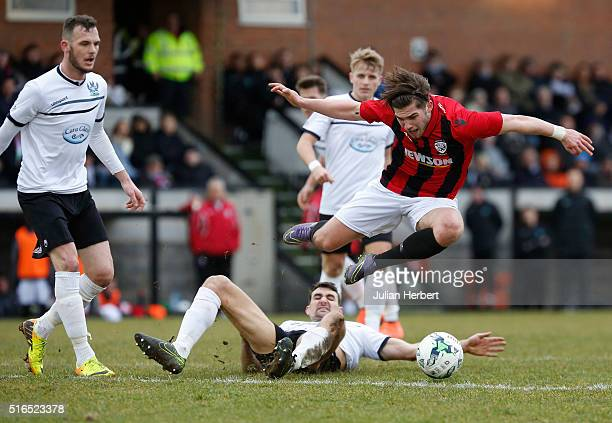 Joe Tumelty of Hereford is tackled by Kane O' Keefe of Salisbury during the FA Vase Semi Final Second Leg Match between Salisbury and Hereford at The...