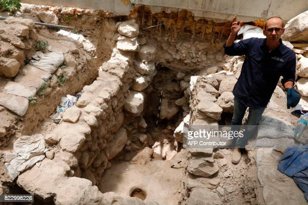 Joe Uziel of the Israel Antiquities Authority who is the director of an excavation project where evidence of the destruction of Jerusalem by the...