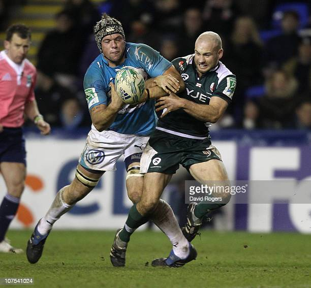 Joe van Niekerk of Toulon is challenged by Paul Hodgson to the loose ball during the Heineken Cup Pool 3 match between London Irish and Toulon at...