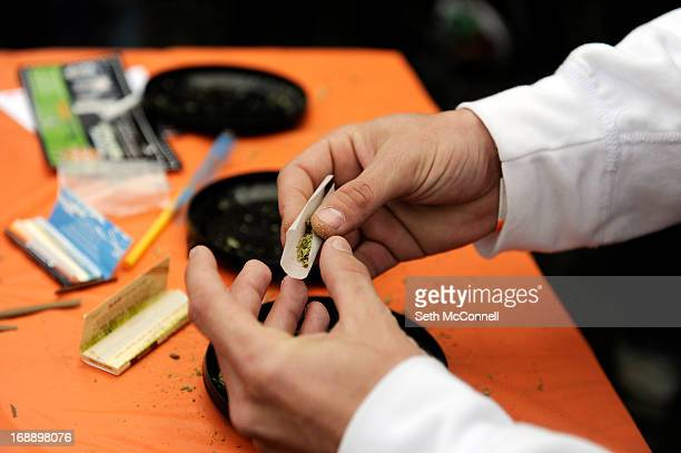 Joe Vega III of Tampa Florida rolls a joint on Captain Kirk's portable joint rolling table during the High Times US Cannabis Cup at the Exdo Center...
