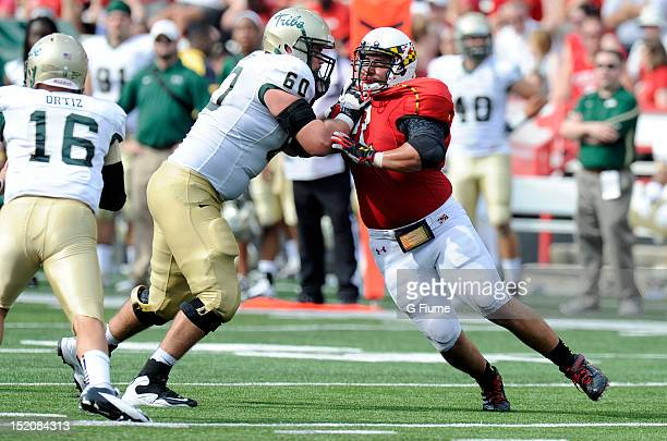 Joe Vellano of the Maryland Terrapins rushes against Robert Gumbita of the William Mary Tribe at Byrd Stadium on September 1 2012 in College Park...
