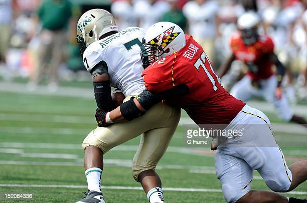 Joe Vellano of the Maryland Terrapins tackles Mikal AbdulSaboor of the William Mary Tribe at Byrd Stadium on September 1 2012 in College Park Maryland